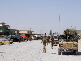 Sangin high street – life goes on for the Afghans while the UK, US and Afghan military patrol presence remains high