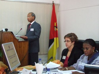 Minister Garrido delivering his speech, with Jane Rintoul and the Vice Minister on the podium