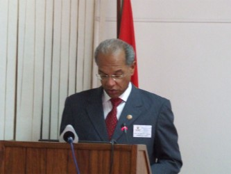 Minister Garrido delivering his address to the joint review meeting