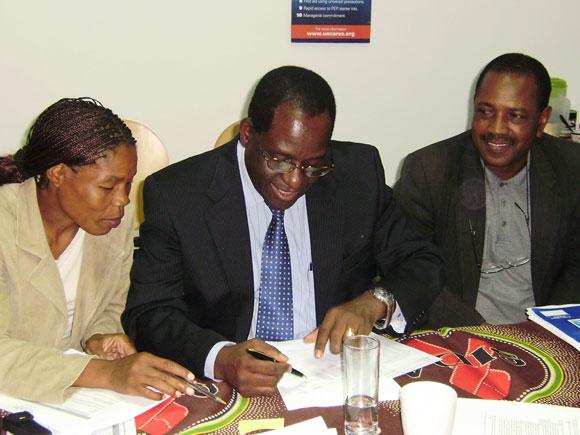 Antonio Laice (centre) signs the application - click for bigger picture