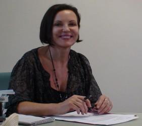 Elizabeth Carriere at desk