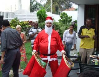 Keith MacKiggan, dressed as Father Christmas, having eaten well!