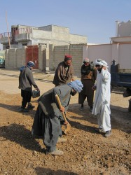 Local builders work on one of the roads in Lashkar Gah
