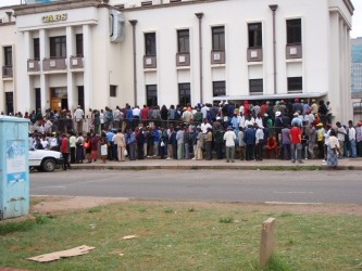 Quite a contrast - people were queueing to use cash machines in Harare last year