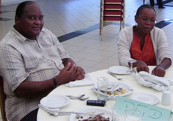 Dr Langa and Etelvina relax at lunch after the mornings discussions