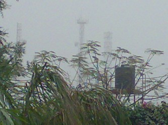 Mobile masts disappear in the Kano gloom