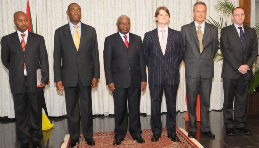 Photo of Neil standing with President Guebuza, Minister Baloi, British High Commissioner Shaun Cleary and the Deputy High Commissioner David Hinchon.