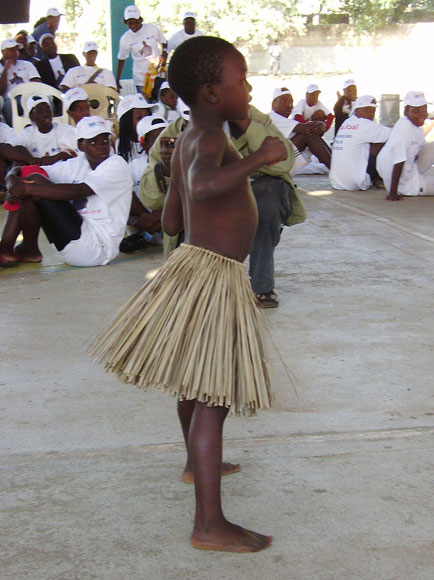 Photo of a young boy in a grass skirt