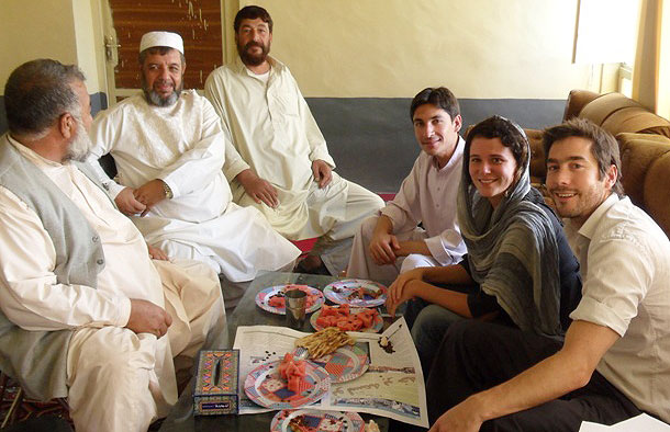 Photo of Tim and a colleague having diner with some Afghanistan locals