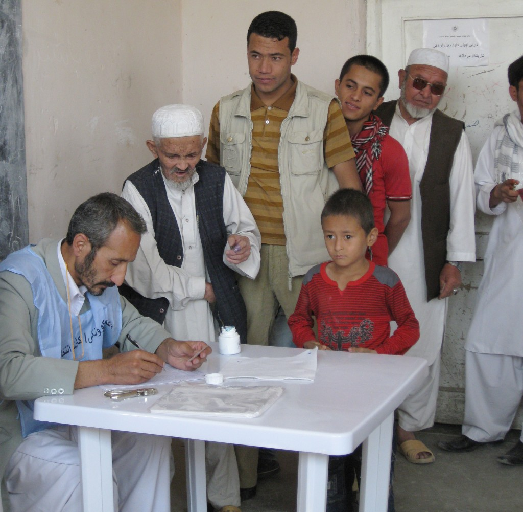 Photo of people voting at a polling station