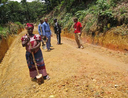 Photo of a woman on a road