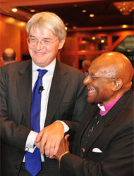 Smiles all round: Secretary of State Andrew Mitchell with Archbishop Desmond Tutu. Picture: USAID