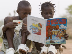 Education: Sadia and a friend learn about Guinea worm disease from a comic. Picture: The Carter Center
