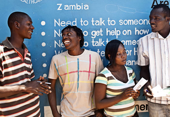 Advice: peer educators in Zambia offer information about family planning. Picture: Charlie Shoemaker/Marie Stopes International