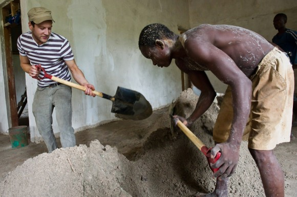Digging in: helping to shovel cement with a worker building a new health clinic in Tanzania. Picture: Jonathan Banks/Comic Relief
