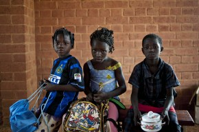 Children at a new school in Laongo, Burkina Faso take a break for lunch. Picture: Andrew Testa/Panos