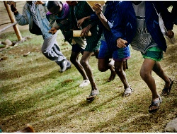 Children race to school for morning lessons. Picture: Chris de Bode/Panos