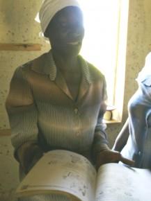 A teacher holds open a book