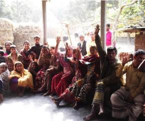 Members raising their hands to vote