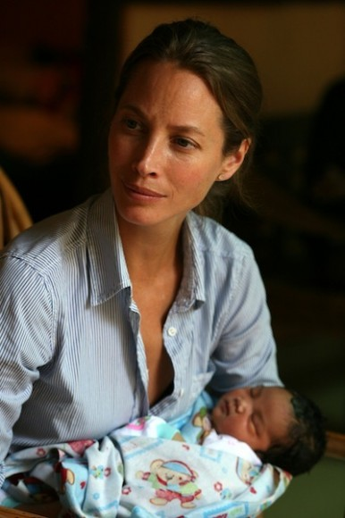 Christy holds a newborn baby