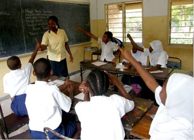 A primary school teacher answering questions in her class. Picture: Neema Kambona/DFID