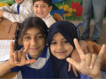 Children at the Deaf Reach School trying to teach me sign language. Picture: Asyia/DFID