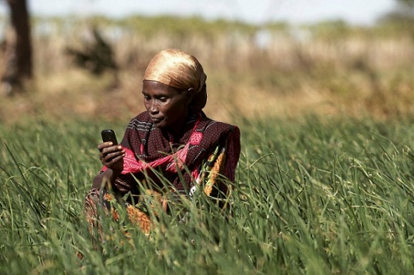 Hasha Kalcatcha, a 35 year old Borana woman, checks her mobile phone before deciding whether to harvest her crops. Picture: Piers Benatar/Panos