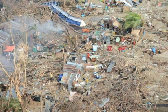 Piles of rubble and debris in Estancia in Panay Island. Picture: HMS Daring.