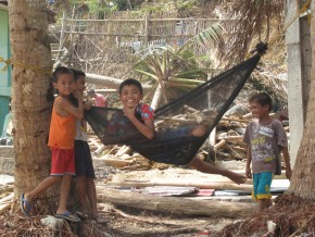 Children play in a hammock in Tanza, on Panay Island. Picture: Henry Donati/DFID.