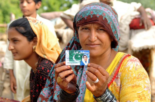 Noor Bhari, 54, proudly displays her debit card provided under Pakistan's national Income Support Programme (BISP). Picture: World Bank.
