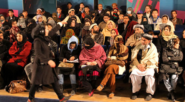 Floor manager Tahmina Kargar gets the audience ready for an episode of Open Jirga.