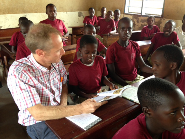 Ian sits in class with children. Picture: Ian Attfield/DFID
