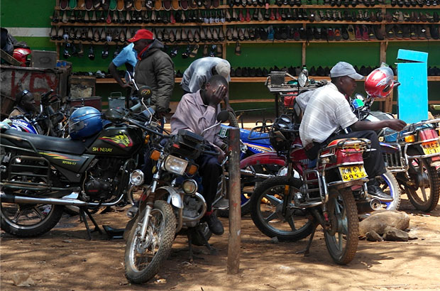 Motorbikes are much easier to navigate on rural roads and these 'boda boda' motorcyclists are making the most of the opportunity. Picture: Marcus Ryder.