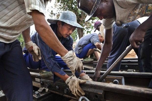 Chinese and African construction teams work together on a development project in Angola. Picutre: Dieter Telemans/Panos