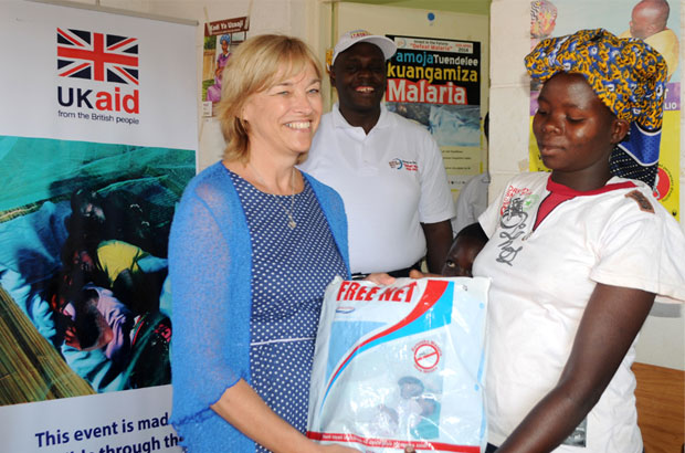Lisa Phillips handing over bed-nets at the dispensary on World Malaria Day. Picture: DFID Kenya