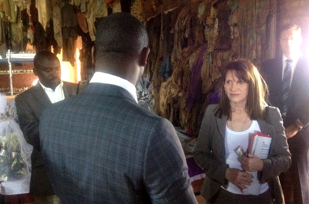 Lynne Featherstone at the genocide memorial at Ntarama church. Remnants of clothes and shoes belonging to those who perished are seen in the background. Picture: Jennifer Harris/DFID