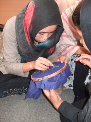 A young woman is trained in needlework. Picture: Zardozi