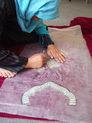 A woman hard at work. After a short training period – in tailoring and business skills – women are then encouraged to set up their own businesses. Picture: Zardozi