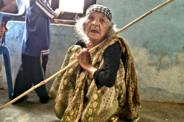 Pabitra Damai poses with her walking stick and her grandson after opening her first bank account. Picture: Prasanna Bahadur/DFID