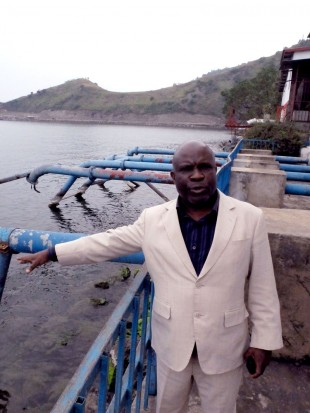 The local head of Regideso explains how water is extracted from Lake Kivu. Picture: Chris Pycroft/DFID.