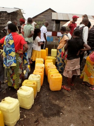 Queuing for water at the standpipe. Picture: Chris Pycroft/DFID.