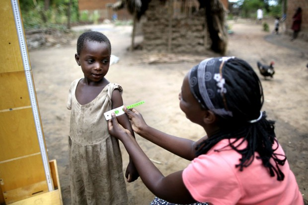 A young Tanzanian girl in Kunke village is checked for signs of malnutrition. Picture: Brian Sokol/IDRC/Panos