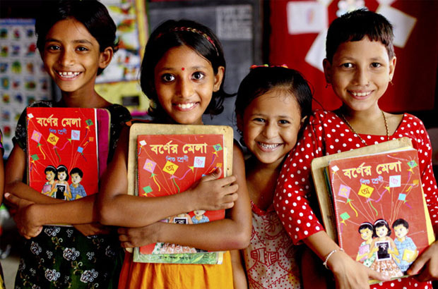 Young Bangladeshi girls holding text books. Picture:GMB Akash/Panos
