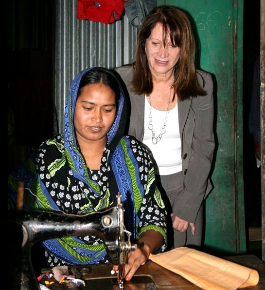 Minister Lynne Featherstone with Ranu, a seamstress who is making use of the solar panels and the electricity they generate to work after dark. Picture: DFID Bangladesh