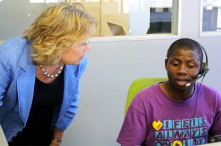 Baroness Northover speaks to a member of staff at LoveLife's new call centre. Picture: Julia Smith/DFID
