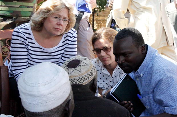 Baroness Northover speaks to some of the older people displaced by the conflict. Picture: Vicky Seymour/DFID