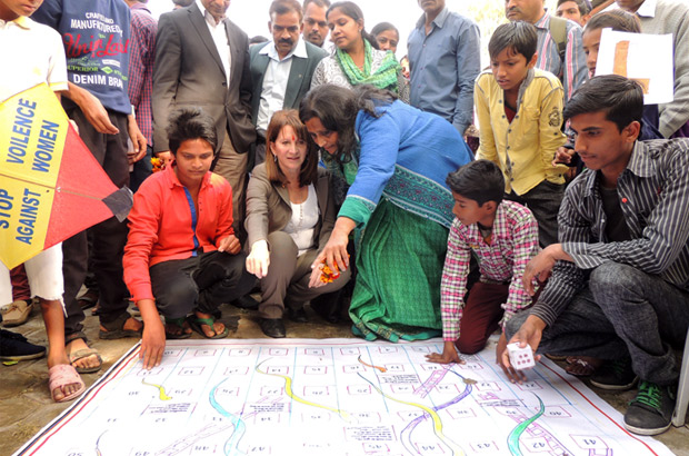 Lynne Featherstone being shown the Snakes and Ladders game that challenges social norms about masculinity. Picture: Anshuman Atroley/DFID India
