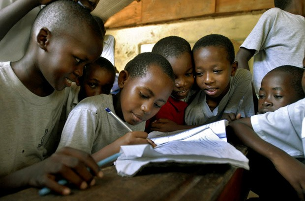 School children in Tanzania work together to solve a maths problem. Picture: Ami Vitale/Panos