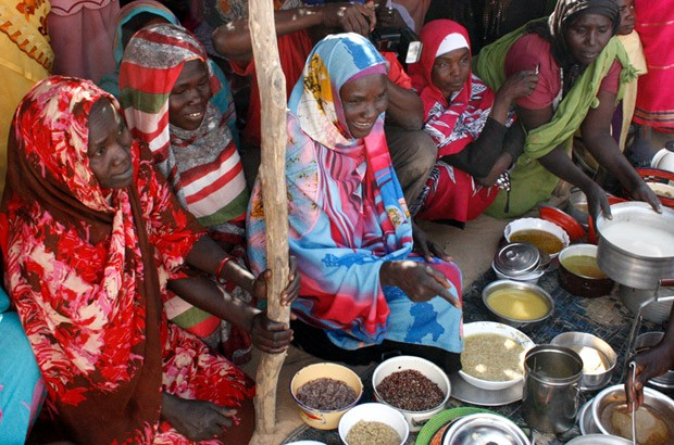 Women in the Ardamata IDP camp prepare sample meals with the vouchers they purchased. Picture: Vicky Seymour/DFID