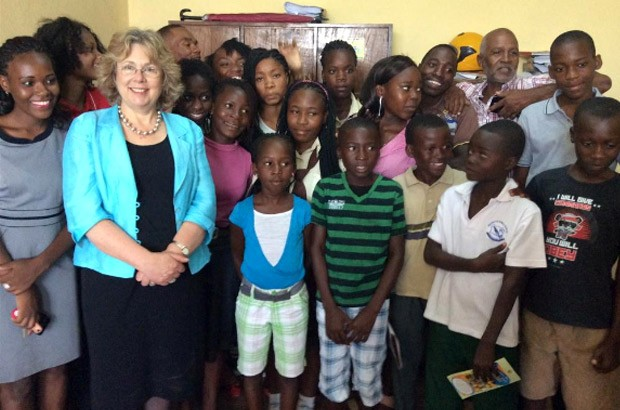 Baroness Northover poses with young children who create radio programmes aimed at ending child marriage. Picture: Baroness Northover
